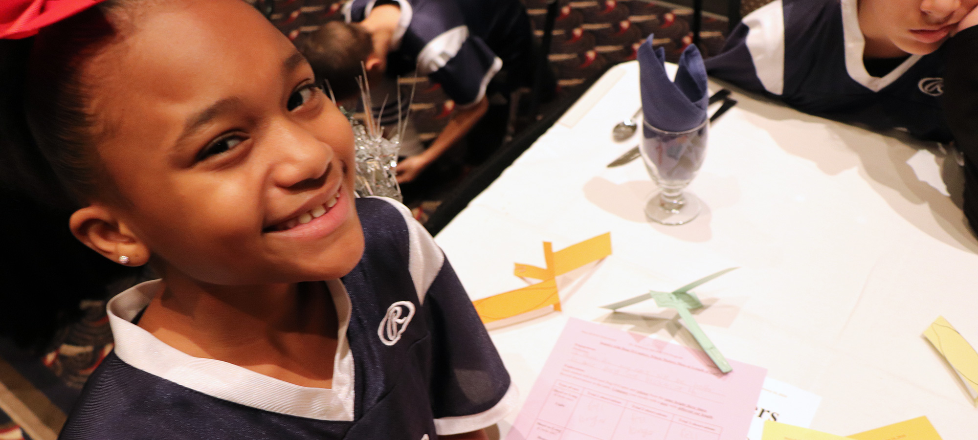 Girl smiling at 2020 Great Futures Dinner
