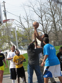 Members playing basketball at the Roy C. Buley Center